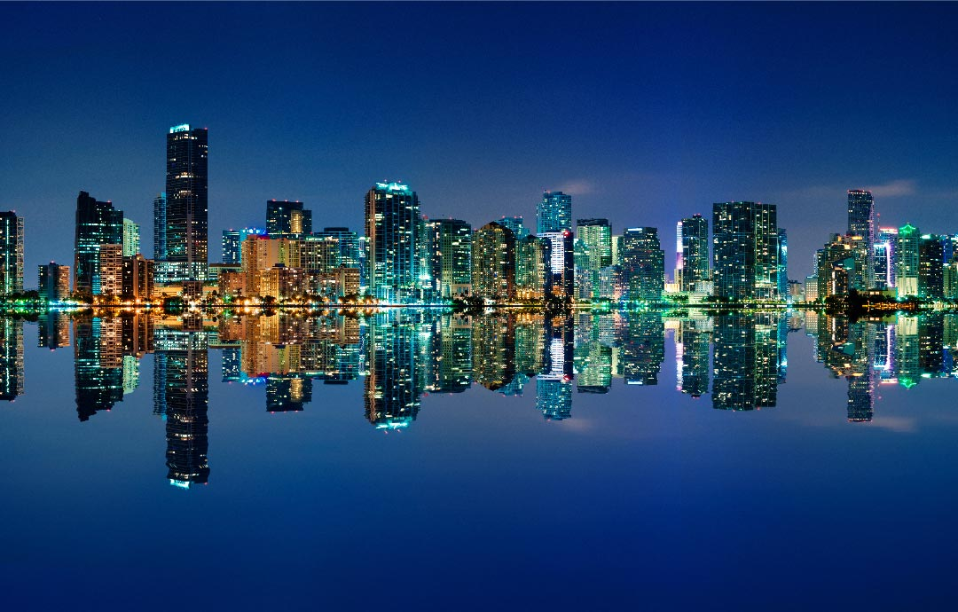 Background image of skyline reflecting on water